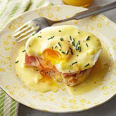 eggs benedict with orange hollandaise sauce (maltaise sauce)