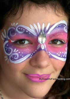 for your masquerade party. Tag pink and purple. DFX white for details. Jewels attached with eyelash glue.