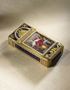 AN GOLD ENAMEL AND PEARL TWO COMPARTMENT AUTOMATON SNUFF BOX FOR THE CHINESE MARKET THE AUTOMATON WORK PROBABLY BY PIGUET AND CAPT, CIRCA 1805