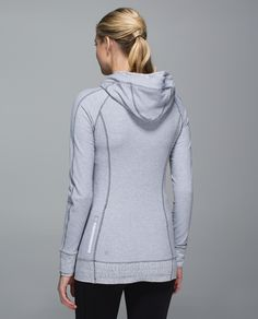 When the weather outside makes us want to cuddle in with a good book instead of lacing up, we slip on this buttery-soft hoodie to help us get going. Soft and warm with reflectivity that helps keep us visible when we're getting physical, this layer is sweat and post-practice perfection.