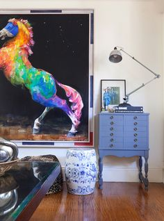 Love the rainbow horse piece and the painted side chest.