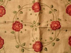 Embroidered pillow cover in the Arts and Crafts Style circa 1910.