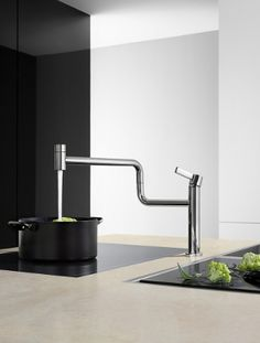 Dornbracht's Pivot fully incorporates all water-based needs in the kitchen! With a 360-degree radius, this works wonders as a combination faucet and pot-filler.