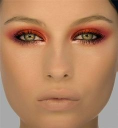 Red rimmed eyes, nude makeup. Not everyone could wear this, but the look is striking!