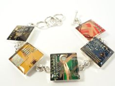 Inspired by unused computer components, a laid-off single mom started recycling computer parts into jewelry that's now attracting some significant attention.