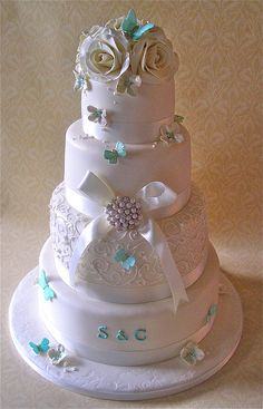 Ivory & turquoise four-tier wedding cake by Nice Icing, via Flickr – beautiful! 4 Tier Wedding Cake, Wedding Cake Cookies, White Wedding Cakes, Elegant Wedding Cakes, Beautiful Wedding Cakes, Gorgeous Cakes, Wedding Cupcakes, Pretty Cakes, Amazing Cakes