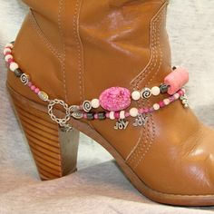 Boot Bracelet  http://www.etsy.com/listing/98583207/beaded-boot-bracelet-with-pink-natural