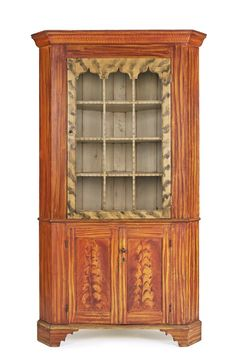 Sold For $9,500  York County, Pennsylvania painted corner cupboard, mid 19th c., with smoke decorated twelve-lite doors, the base with sunken panel doors, all resting on bracket feet, retaining its original red and yellow surface, 89'' h., 50 1/2'' w.                            Condition report           Overall good condition. Upper section has been reduced in height. Evidence of closures removed.