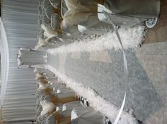 heavenly all white ceremony. feather aisle  http://www.yourdesigndiva.com/