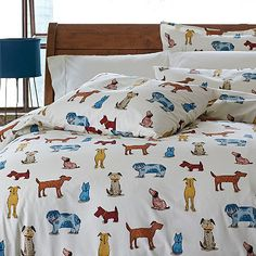 On these fanciful sheets & bedding set, mutts, sheepdogs, beagles, scotties and more form a happy cast of characters that add whimsy to any room.