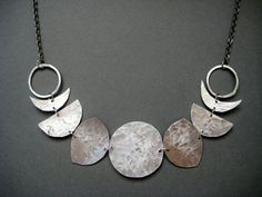 Image result for faces of the moon sheet metal necklace