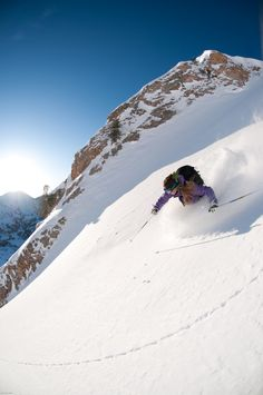 To be the first to make a track up on the mountain is a fantastic feeling! Powder skiing at Alta Ski Resort, Utah