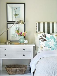 striped headboard and floral pillow on white bed #bedroom #home