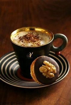 coffee.quenalbertini: Coffee, cream & a great walnut cookie