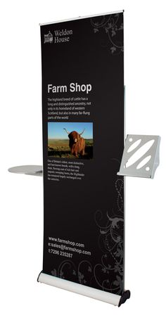 Pull up banner stand with attached brochure shelf