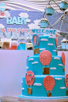 Rachel J Special Events: Up Up and Away Hot Air Balloon Themed Welcome Baby Party. Turquoise and Coral color scheme, hot air balloon cake.