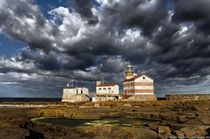 Märket lighthouse on a stormy morning. The border between Finland and Sweden runs through the small Märket island in the Baltic Sea. The pool in the front is in Sweden, while the lighthouse and the two other buildings are located in Finland. Sun And Water, World View, Baltic Sea, Archipelago, Beautiful Islands, Natural Wonders, Light In The Dark, Countryside, Cool Pictures