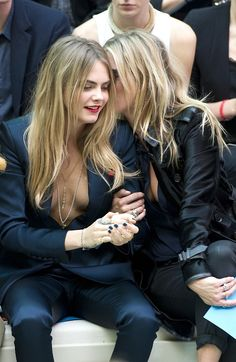 Cara Delevingne and Kate Moss attending the Burberry Prorsum S/S 15 Show