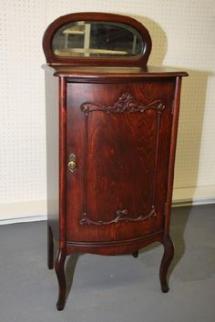 This is a mahogany 1923 sheet music cabinet I just re-finished. I ...