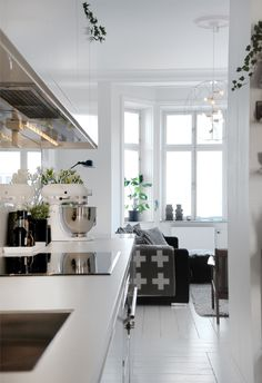 Frog Hill Designs Blog We always love a simple white kitchen.  Love the white hardwood floors, so clean and modern.  #whitefloors #modernkitchen #traditionalkitchen
