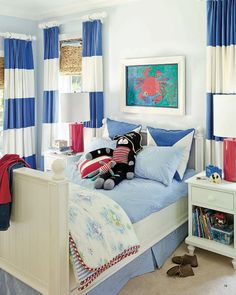 How cute is this bedroom? Love the wide-striped drapes. Home designed by Dana Small via House of Turquoise