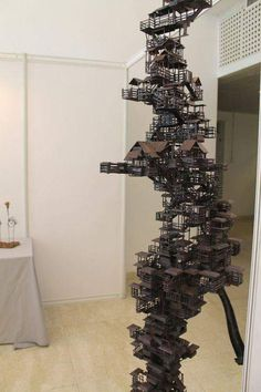"""""""Tower to Heaven"""" by Beijing-based artist Ding Hao This sculpture is crafted entirely from hand-crafted wood pi. Art Actuel, Architectural Sculpture, 3d Modelle, Wargaming Terrain, Modelos 3d, Cardboard Art, Miniature Houses, Sculpture Art, Architecture Design"""