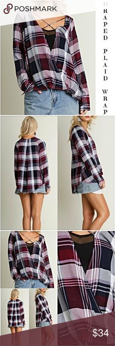 "Draped Criss Cross Hi Low Plaid Wrap Top SML Add some flare to your plaid in this gorgeous draped front hi low criss-cross front wrap-top in plum.  Needs to be worn with a Cami or tank underneath as this is an open front wrap style. Loving the Draped front to cover tummy issues Super cute with any denim & transitions nicely from season to season.   65% cotton 35% Polyester  Measurements taken from a small Bust 42"" Front Length 24"" Back 27"" Tops"