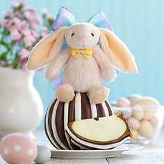 There's no sweeter way to celebrate Easter than with Mrs. Prindables' Snuggle Bunny Triple Chocolate Jumbo Caramel Apple Gift Set. A caramel-dipped apple is coated with dark, milk and white chocolates, then topped with a plush bunny for a sweet finish.