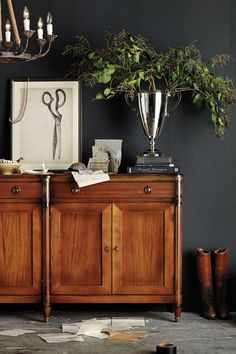 Dark gray sets of a gorgeous honey brown cabinet from Ballard Designs. BM Kendall charcoal