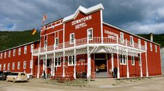 Downtown Hotel, Dawson City, Canada A local night out in Dawson City Get a taste of old-school Canada – and maybe a toe -- in this historic northern settlement, with heritage buildings, authentic frontier town ambiance and character-packed saloons. Alaska Highway, Alaska Trip, Highway Road, Ontario, Yukon Territory, Downtown Hotels, Northwest Territories, Photo Essay, Canada Travel