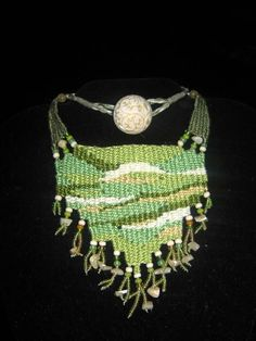 """Lost in the Woods"" - 2011 - Fixed length choker, vintage button closure, asymmetrical design.  Modeled on ""Forrest.""  Private Collection. Woven by Terri Scache Harris, theravenscache.shutterfly.com   Hand woven, handwoven, weaving, weave, needleweaving, pin weaving, woven necklace, fashion necklace, wearable art, fashion necklace, fiber art."
