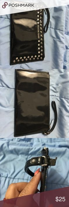 Michael Kors wrislet Ok condition Michael Kors wrislet with bedazzle all around the front of it. It's black patent leather wristlet. The 3rd picture is a picture of strap part that are torn. Still intact. Some small imperfections on the leather of the wristlet. Michael Kors Bags Clutches & Wristlets