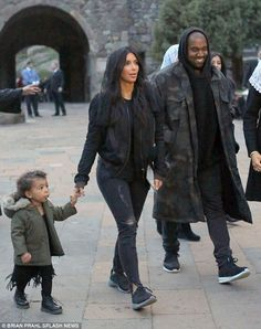 Family time: Kim can be seen holding North's hand while she and Kanye tour Armenia...