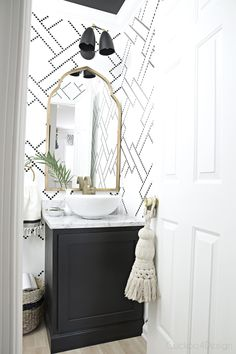 black and white stenciled powder room with black cabinet, white vessel sink, marble counter and gold accents The new gold arched mirror is here Source by jakonya The post The new gold arched mirror is here appeared first on Susannah Kenny Interiors. Downstairs Bathroom, White Bathroom, Small Bathroom, Bathroom Ideas, Bathroom Vintage, Marble Bathrooms, Wall Paper Bathroom, Modern Bathroom, Gold Mirror Bathroom