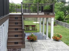 Stamp Concrete Patio with white columns supporting the deck