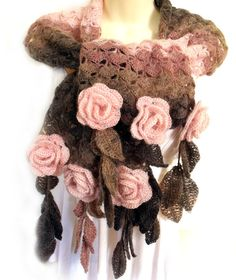 Crochet scarf is embellished with 3D crochet freeform roses and leaf fringe. Colors are dark chocolate brown, mocha, and dust pink. A combination