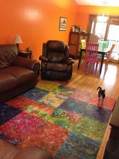 Bohemian rug!! DIY with batik fabric squares, painters cloth, mod podge and polyacrylic.
