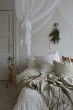 How to get your bedroom holiday ready: simple add fir tree clippings and layer it up with tactile textures and loads of cushions | boho scandinavian bedroom interior | tonal cushion covers | Bemz cushion covers