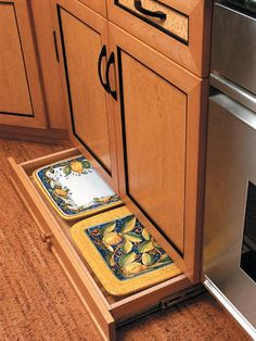 Kitchen - Integrated Cabinets - Toe-kick drawers utilize wasted space along the baseboards.