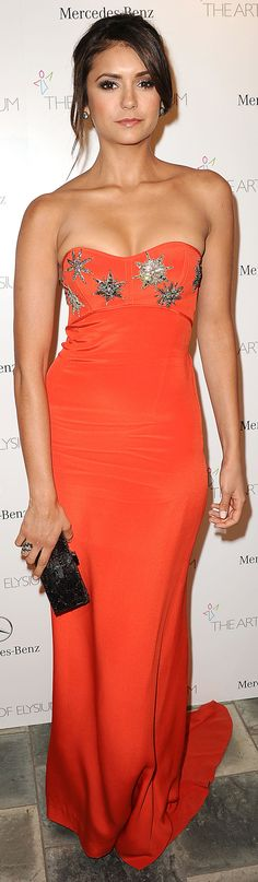 Nina Dobrev was super sexy in a long orange gown      Orange/red is her color