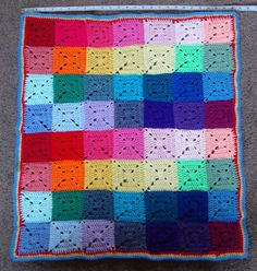 Newly made Crochet solid Granny square multi-coloured Throw, Afghan (for baby or toddler) Patchwork blanket.  This completed measures 30.5 x 26