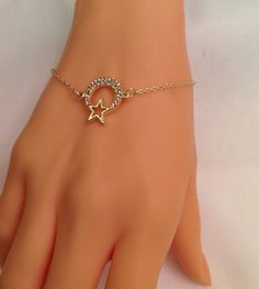 A personal favorite from my Etsy shop https://www.etsy.com/listing/231222331/gold-plated-moon-star-braceletgold