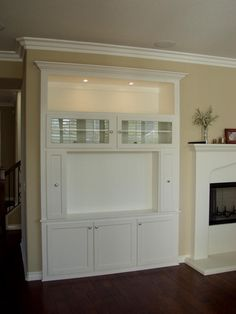 Built in TV Niche | This unit features glass doors over the components, a large lighted ...