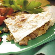 Onion Sausage Quesadillas Recipe -My husband and I created this recipe after we realized you could add anything to caramelized onions and it would taste great. These are easy to whip up, and the filling can be made ahead of time.—Lisa Harrington, Halifax, Nova Scotia
