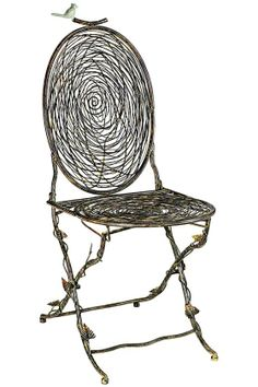 Nest Folding Chair is expertly designed to look like intertwined twigs, but is actually crafted of solid iron. Perfect for both indoor and outdoor locations, this charming chair will add charming personality to your space.
