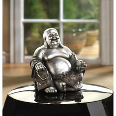 The Happy Buddha brings forth wealth and abundance. Enjoy the infectious smile of this stunning black and silver Buddha statue as it enhances the joy in your home, workplace, or favorite meditation spot. Size: 5 x x 5 high. Silver Anniversary Gifts, Anniversary Decorations, 25th Anniversary, Discount Home Decor, Sitting Buddha, Sitting Poses, Black Accents, Feng Shui, A Table