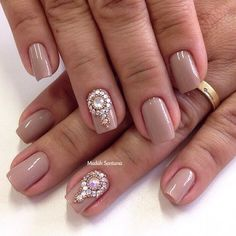 Nude nails with a rather extravagant collection of embellishments on top. If you're feeling glorious for the day why not try this simple yet very sophisticated style and add your prettiest silver and gold beads on top of your nails.