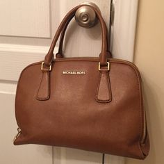 Michael kors hand bag Michael kors hand bag. Used and a little worn. Ink stains on inside. Handle worn. Michael Kors Bags Satchels
