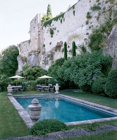 pool by old stone wall