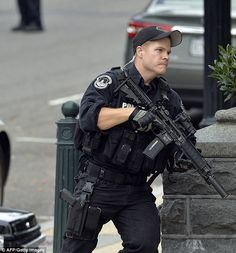 A policeman runs after shots fired were reported near Street NW and Constitution Avenue on Capitol Hill in Washington, DC, on October Lookin' like the bad ass he is. Swat Police, Police Gear, Police Uniforms, Police Officer, Military Armor, Military Police, Army, Bodyguard Services, Hot Cops